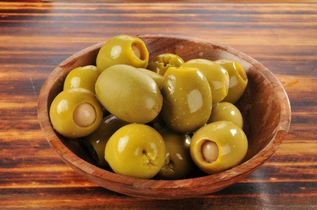 olive green: A bowl of green olives stuffed iwth anchovies