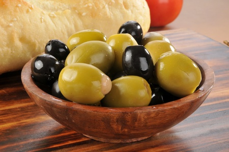 olive green: A bowl of green and black olives stuffed with minced anchovies
