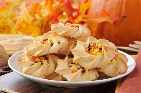 shortbread: Shortbread cookies with orange and yellow candy sprinkles in a festive autumn or fall holiday setting Stock Photo