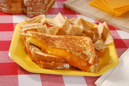checker plate: A grilled cheese sandwich on a checkered table cloth Stock Photo