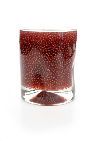 A glass of grape kombucha, a tea based fermented drink known for its health giving qualities