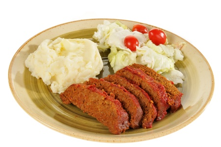 meatloaf: A plate of meatloaf on a white background Stock Photo