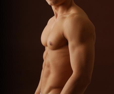 desnudo masculino: Primer plano de una sexy torso masculino desnudo