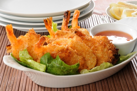 breaded: Anappetizer of coconut shrimp with sweet sauce