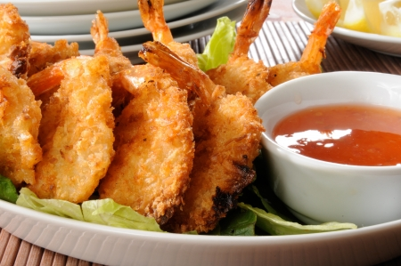 A plate of delicious coconut shrimp prawns and sauce Banco de Imagens
