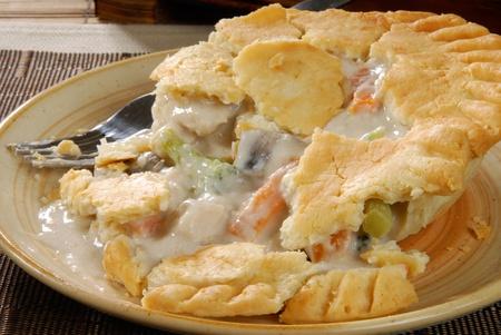 A hot chicken pot pie on a plate photo