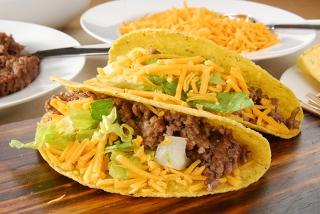 a close up photo of fresh tacos and taco ingredients