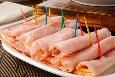 A tray of ham and cheese rollups