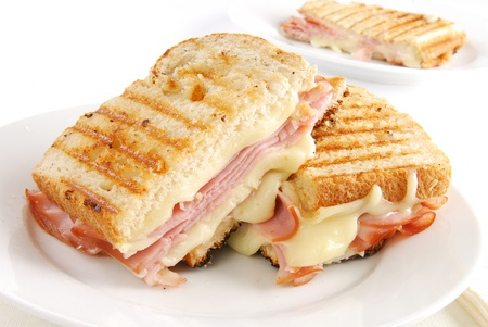 A grilled ham and swiss cheese sandwich 스톡 콘텐츠