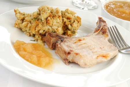 stuffing: A pork chop with apple sauce and stuffing Stock Photo