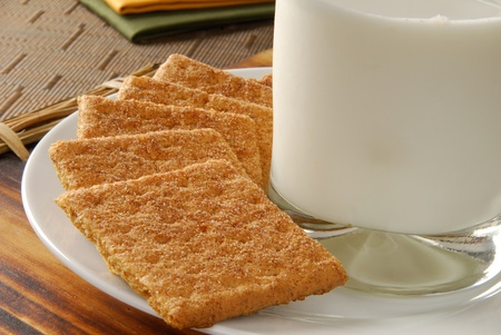graham: Close up photo of graham crackers with a glass of milk Stock Photo