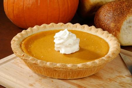 A fresh pumpkin pie, a Thanksgiving or holiday treat photo