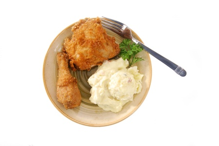 A plate of fried chicken with potato salad Stok Fotoğraf