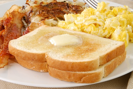 scrambled: A breakfast of toast, bacon and scrambled eggs Stock Photo