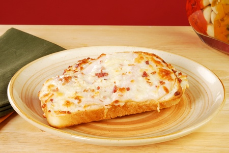 turkey bacon: An open faced sandwich with turkey, bacon and cheese on sourdough bread