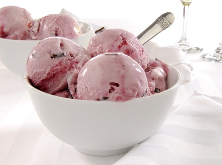 black dish: A bowl of black cherry and chocolate ice cream
