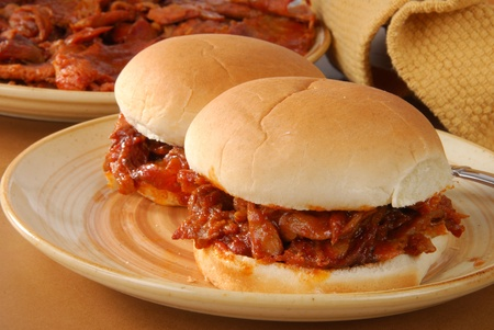 heaping: Two barbecue beef sandwiches on buns