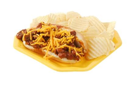 A chili cheese dog and potato chips photo