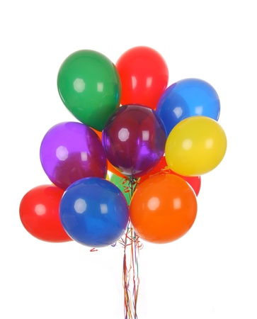 a bouquet of colorful helium balloons on a whte background