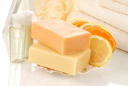 Luxury bars of citrus infused soaps and toiletries in a spa setting Foto de archivo