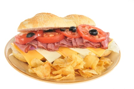 A roast beef sub sandwich with potato chips photo