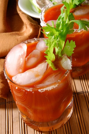A Bloody Mary coctail with a celery garnish Imagens