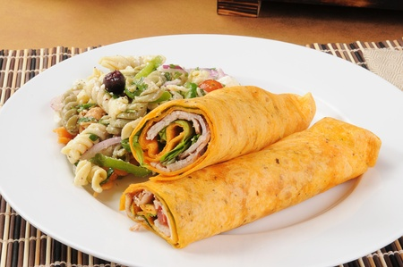 a smoked turkey wrap with Mediterranean pasta salad