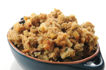 A baking dish of seasoned stuffing on a white background Stock Photo - 13565679