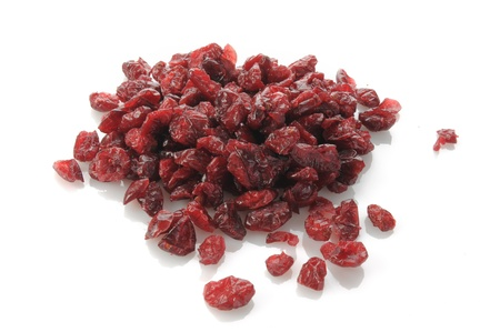 A mound of dried cranberries on a white background Stock Photo