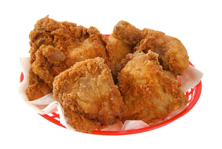 a red basket of fried chicken