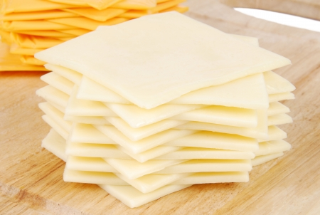 swiss cheese: A stack of Swiss cheese slices Stock Photo