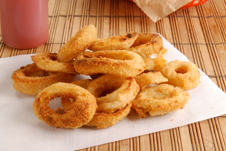 Fresh onion rings on a sheet of white paper