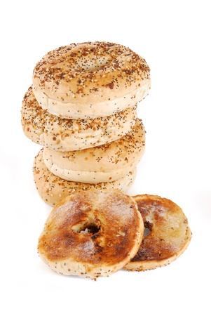 buttered: A stack of bagles with a toasted buttered bagel