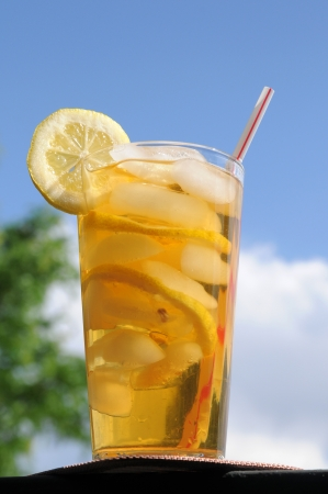 A tall glass of iced tea in the summertime photo