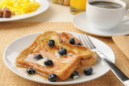 A plate of french toast with blueberries photo