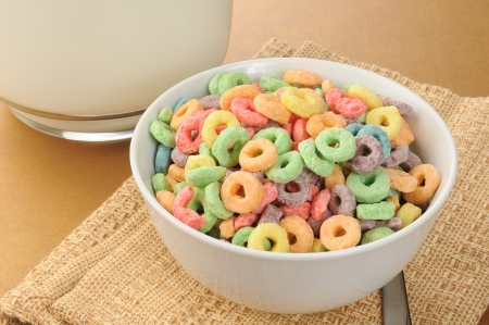 A bowl of fruit rings cold cereal with a pitcher of milk Stock Photo - 13662883