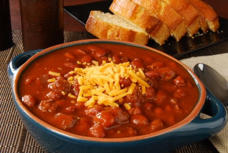 cornbread: A crock of chili with shredded cheese and cornbread
