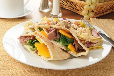 Roast beef in pita pockets with a Greek salad photo