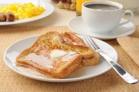 A plate of french toast with maple syrup Stock Photo
