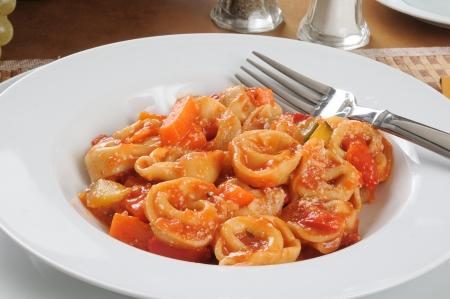primavera: A bowl of four cheese tortellini primavera parmesan