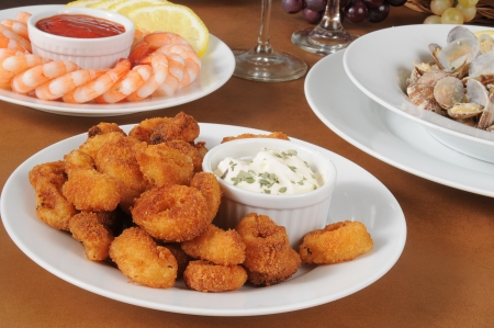 Breaded calamari rings with shrimp and steamed clams Stock Photo - 13831180