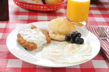 smothered: A chicken fried steak smothered in country gravy wiht fried eggs