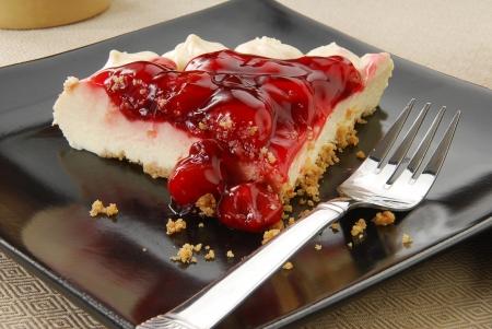 graham: A slice of french vanilla cheesecake with graham cracker crust Stock Photo