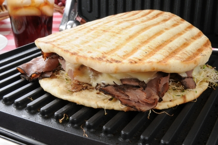 a roast beef panini on flatbread still on the grill photo