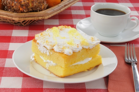 A slice of cream filled lemon cake with coffee Stock Photo - 14009665