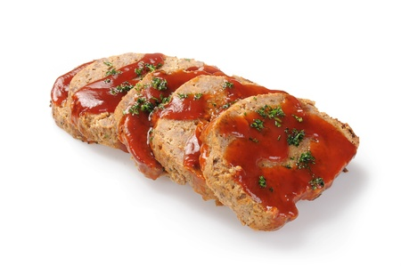 Sliced meatloaf on a white background photo