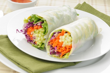 spring roll: A vegetarian spring roll with avocado, red cabbage, carrots, lettuce Stock Photo