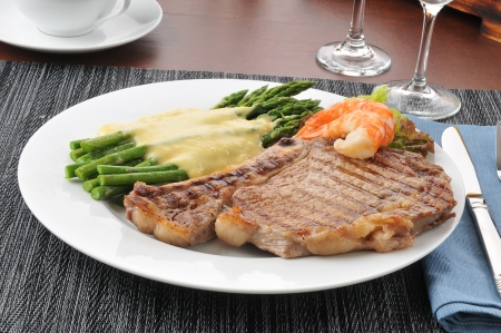 Steak and seafood dinner with asparagus topped with Hollandaise sauce Stock Photo - 14109125