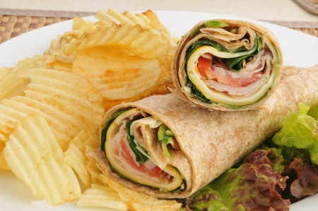 Smoked turkey wraps with cheese and tomato photo