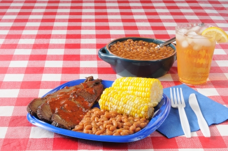 baked beans: sliced beef brisket and boston baked beans with copyspace